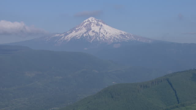 snowy peak of mount hood with mountain forest foreground - mt hood stock videos & royalty-free footage