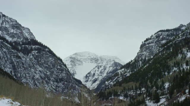 snowy peaks and valleys of the san juan mountains of the rockies in winter over ouray, colorado under an overcast sky - evergreen stock videos & royalty-free footage