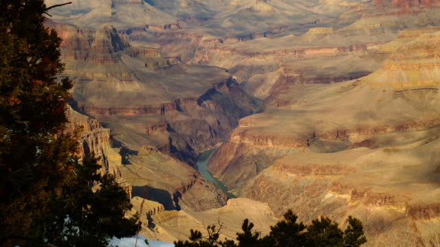 a snowy ridge looks out over the grand canyon. - fiume colorado video stock e b–roll