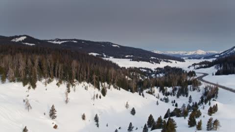 snowy road in teton range - aerial - teton range stock videos & royalty-free footage