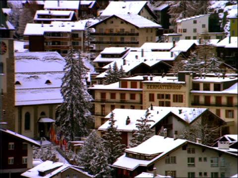 Snowy Swiss mountain village with Matterhorn background / Zermatt