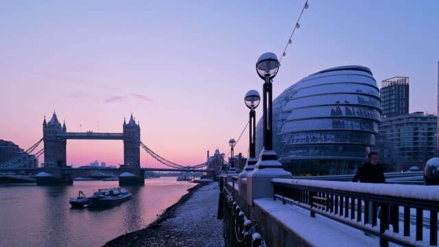 a snowy tower bridge and river thames at dusk, london, uk - river thames stock videos & royalty-free footage