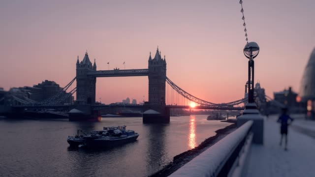 A snowy Tower Bridge and River Thames at dusk, London, UK