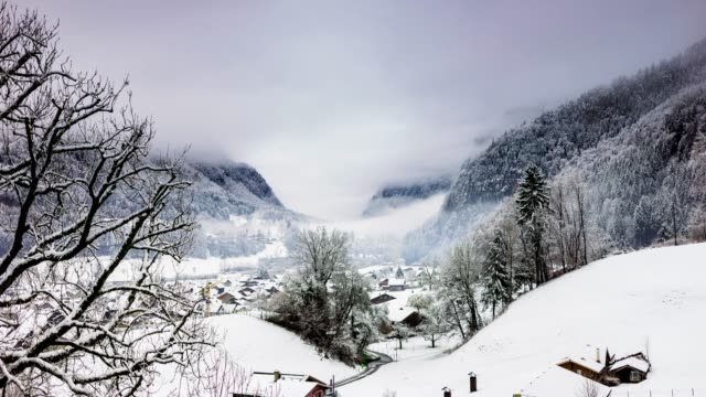 snowy valley in the swiss alps - time lapse - chalet stock videos & royalty-free footage