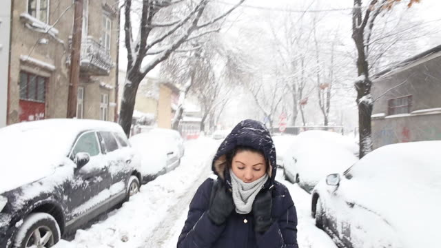 snowy walk on the street. - winter coat stock videos & royalty-free footage