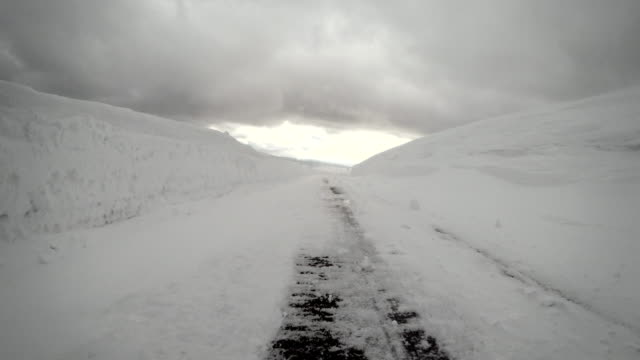 snowy winter road drive - 4k - - sports activity stock videos & royalty-free footage