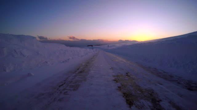 Snowy winter road drive at dusk- 4K -