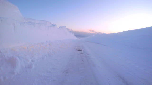 snowy winter road drive at dusk, car passing - plusphoto stock videos & royalty-free footage