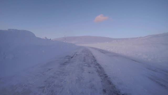 snowy winter road drive at dusk - plusphoto stock videos & royalty-free footage