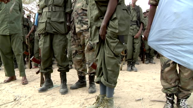 so he can evaluate if he can battle with them Militia man showing his shoes to colonel on July 31 2011 in Dhoobley Somalia
