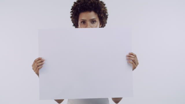 so what do you say? - holding poster stock videos & royalty-free footage