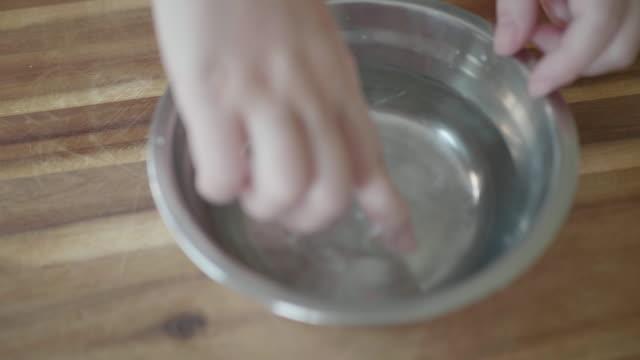 soak gelatin sheet into water - gelatin stock videos & royalty-free footage
