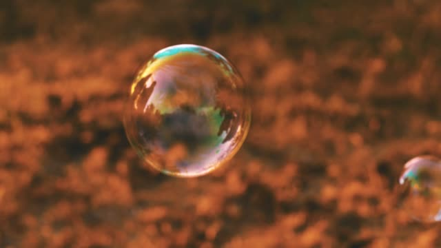 soap bubble flying in the air - bubble wand stock videos & royalty-free footage