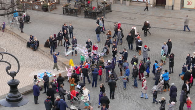 soap bubble street performer in krakow - street performer stock videos and b-roll footage