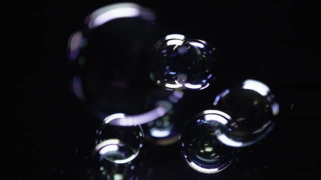 soap bubbles on black background - soap sud stock videos & royalty-free footage