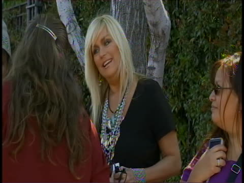 soap opera star actress catherine hickland chats with fan outside walt disney studios in burbank. horn honks as car drives by. the recent... - soap opera stock videos & royalty-free footage