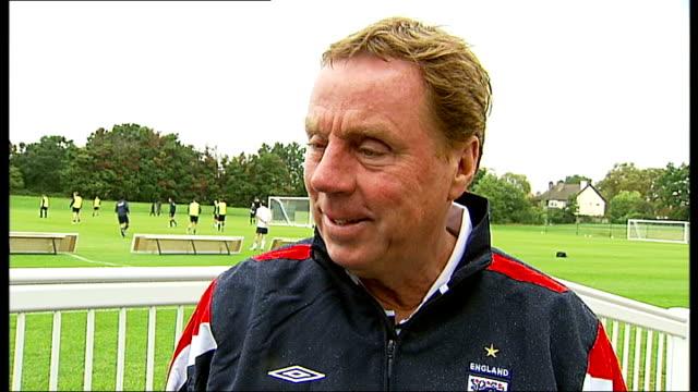 soccer aid charity match england team training harry redknapp interview sot reporter to camera alan shearer - ハリー レッドナップ点の映像素材/bロール