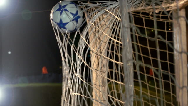goal! soccer ball / football scoring in net - super slow motion - netting stock videos and b-roll footage