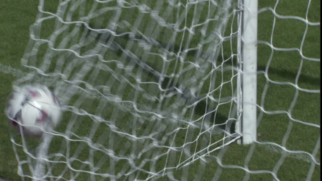 cu soccer ball hitting back of net / sheffield, england, uk - netting stock videos & royalty-free footage