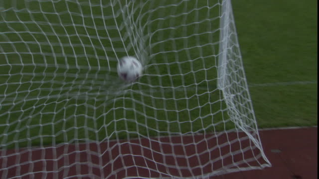 ha zi cu pan soccer ball hitting back of net / sheffield, england, uk - tor konstruktion stock-videos und b-roll-filmmaterial
