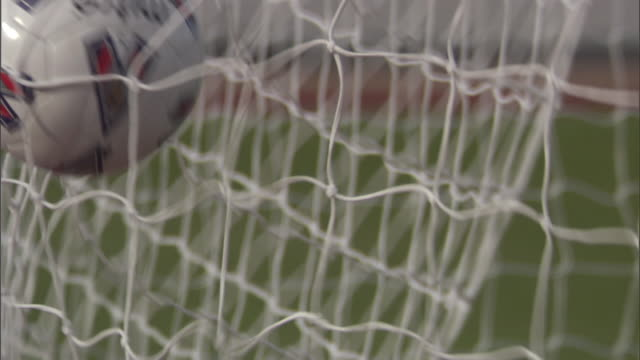 cu soccer ball hitting back of net / sheffield, england, uk - 得点する点の映像素材/bロール