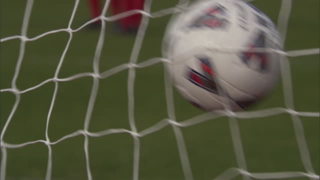 cu soccer ball hitting back of net / sheffield, england, uk - netting stock videos and b-roll footage