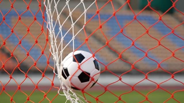 soccer ball into net - scoring a goal - soccer goal stock videos & royalty-free footage