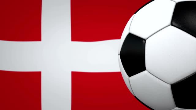 vídeos y material grabado en eventos de stock de lazo de pelota de fútbol con fondo de bandera danesa - danish flag