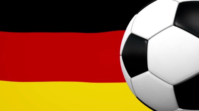 vídeos de stock, filmes e b-roll de loop de bola de futebol com fundo de bandeira alemã - liga esportiva