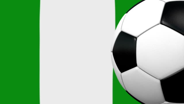 soccer ball loop with nigerian flag background - nigerian flag stock videos & royalty-free footage