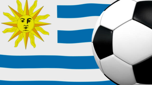soccer ball loop with uruguaian flag background - uruguay stock videos & royalty-free footage