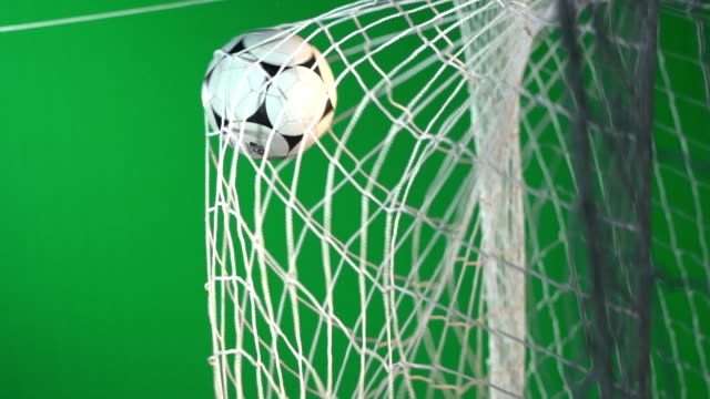soccer ball, scoring football goal in net - chroma key green screen - super slow motion - net sports equipment stock videos and b-roll footage