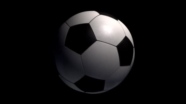 Soccer Ball turning on a black background with alpha.