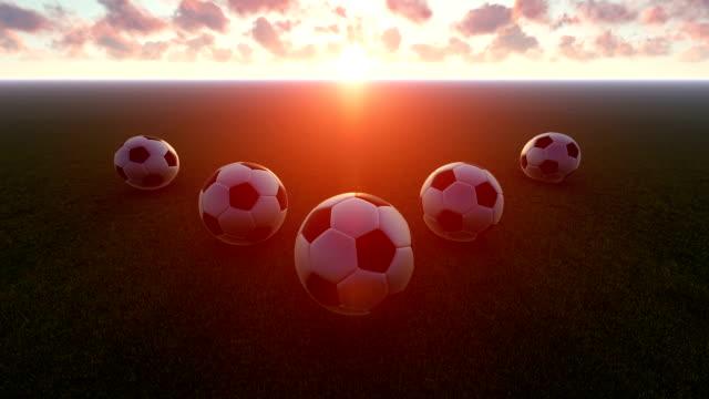 soccer balls at sunset - international team soccer stock videos & royalty-free footage