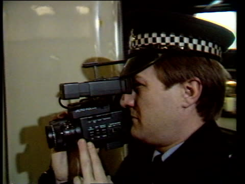 england london euston station ms people standing on concourse pan rl and tilt up and zoom in video camera above departure board cbv policeman as... - アルファベットのb点の映像素材/bロール