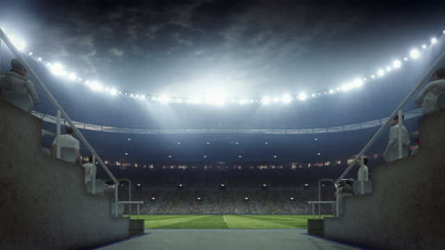 vídeos de stock e filmes b-roll de soccer: entering stadium from players zone - football