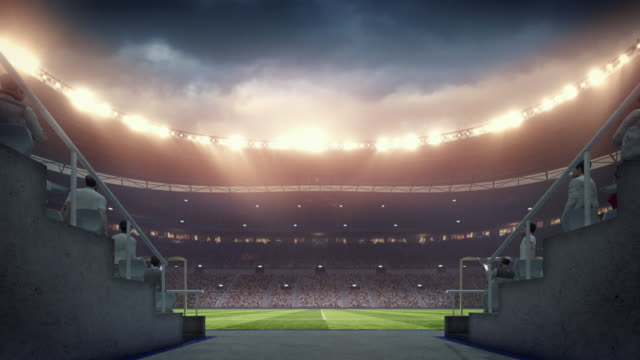 vídeos de stock e filmes b-roll de soccer: entering stadium from players zone - futebol