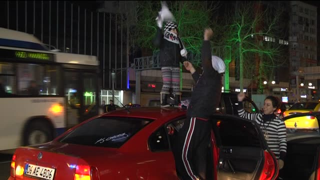 Soccer fans celebrate Besiktas' UEFA Europa League Round 32 victory against Liverpool FC on February 26 2015 at Kizilay Square in Ankara Turkey...