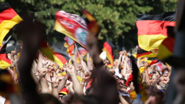 stockvideo's en b-roll-footage met ms pan soccer fans celebrating at public viewing / berlin, germany - duitsland
