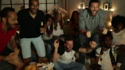 Soccer fans cheering at home