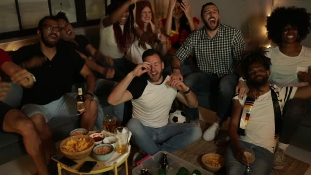 soccer fans cheering at home - turno sportivo video stock e b–roll
