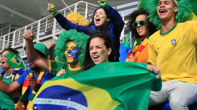 stockvideo's en b-roll-footage met soccer fans cheering brazil but feeling disappointed because they missed - brazilië