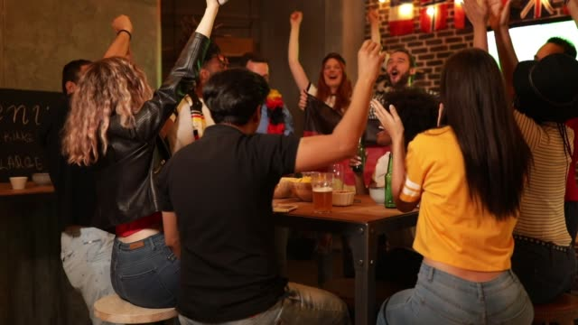 soccer fans cheering - happy hour video stock e b–roll