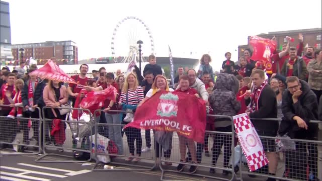 soccer fans line the streets of liverpool in anticipation of their team's opentop bus making its way through the city for their champions league... - soccer association stock videos & royalty-free footage
