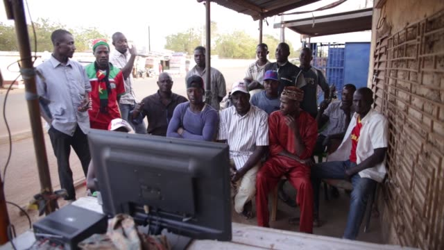 soccer fans of burkina faso watch their national team's match against tunusia on television, during 2017 africa cup of nations, in ouagadougo,... - semifinal round stock videos & royalty-free footage