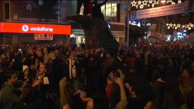 Soccer fans pouring into the streets to celebrate Besiktas' UEFA Europa League Round 32 victory against Liverpool FC on February 26 2015 in Istanbul...