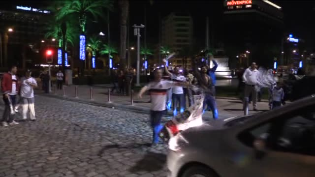 Soccer fans pouring into the streets to celebrate Besiktas' UEFA Europa League Round 32 victory against Liverpool FC on February 26 2015 in Izmir...
