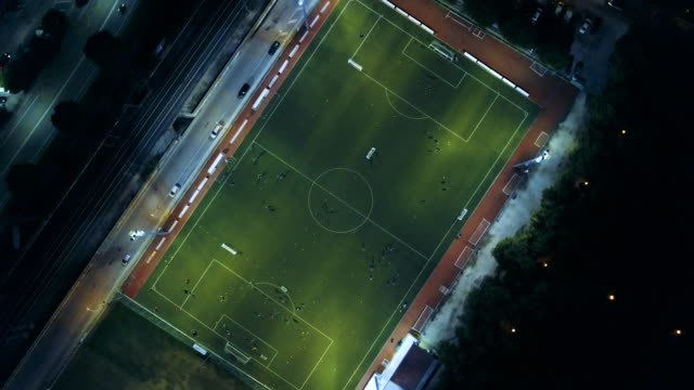 soccer field at night - aerial view - football pitch stock videos & royalty-free footage