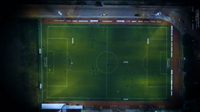 soccer field at night - aerial view - football pitch stock videos and b-roll footage