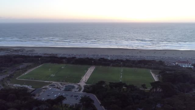 soccer field next to the beach - superwoman stock videos and b-roll footage